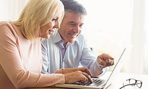 mature couple using laptop