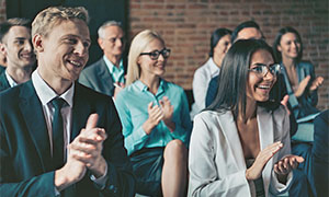 business audience clapping during presentation